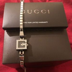 Gucci watch with beautiful VS diamonds
